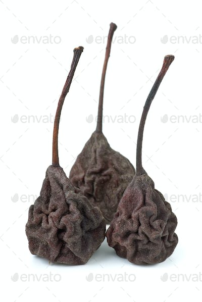 Three dried smoked pears isolated on the white background