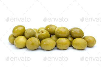 Some green olives with pits