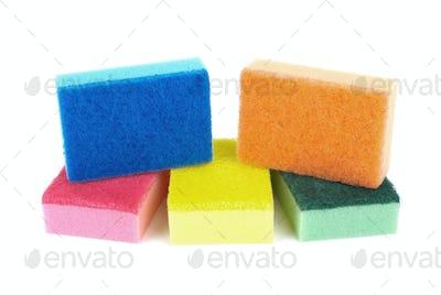 Five sponges of different colors