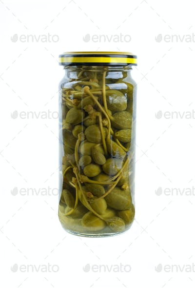 Glass jar with marinated capers fruits