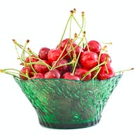 Bowl filled with the red cherries