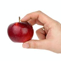 Hand taking red apple
