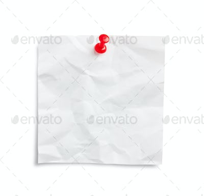 Crumpled note paper with pushpin