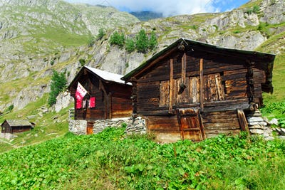 Two traditional alpine huts