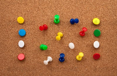 Thumbtacks in cork board