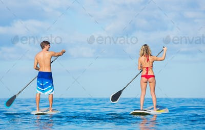 Couple Stand Up Paddling in Hawaii