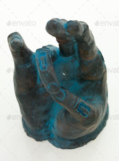 hand sculpture showing spiritual symbol