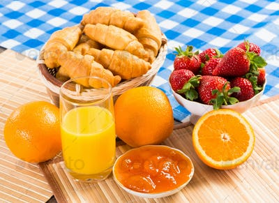 early breakfast, juice, croissants and jam