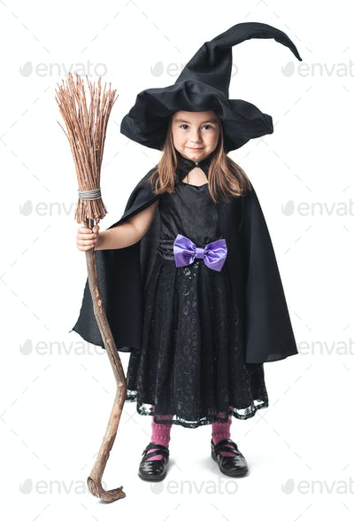 little witch with a broom