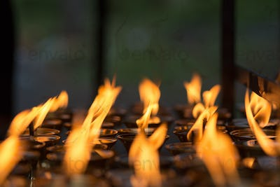 Burning candles in Kathmandu Buddhist temple