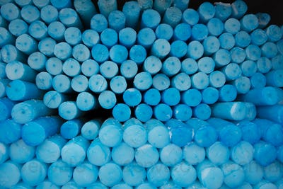 Close up of a group of blue circle candles in Lourdes in France.
