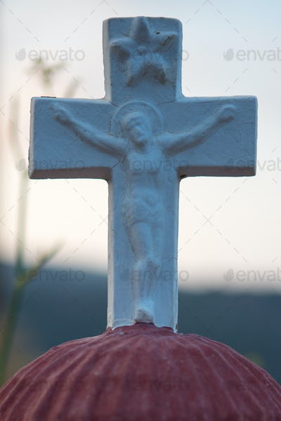 Close up from a cross with a picture of Jezus