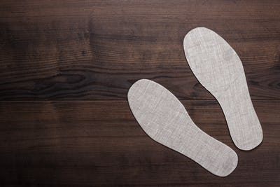 Grey Insoles For Shoes On Wooden Background