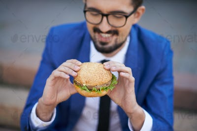 Businessman eating sandwich