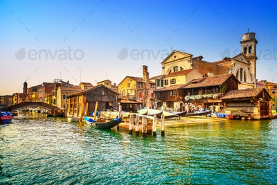 Venice, water canal, bridge and gondolas or gondole depot. Italy