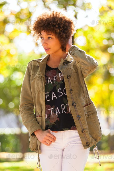 Autumn outdoor portrait of beautiful African American young woma
