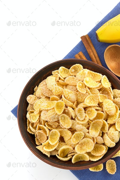 bowl of corn flakes on white