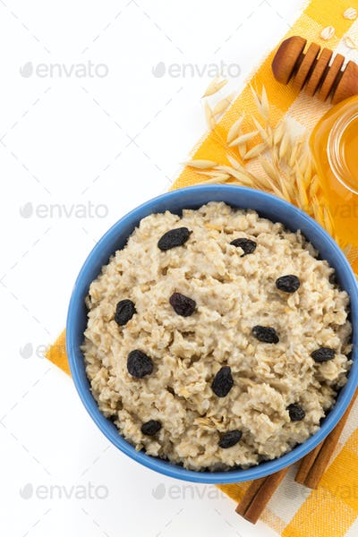 plate of oatmeal isolated on white