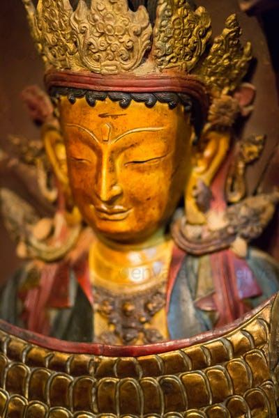 Golden buddha head with crown
