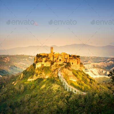 Civita di Bagnoregio landmark, aerial panoramic view on sunset. Italy
