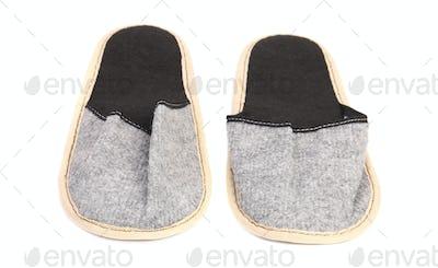 Pair of gray slippers.