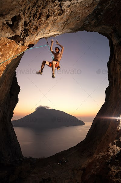 Rock climber falling a cliff while lead climbing