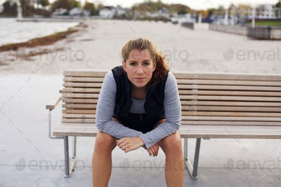 Beautiful young woman taking a break from running