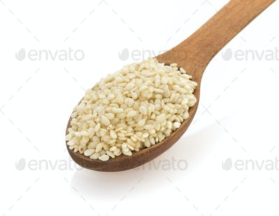 sesame seed in spon on white
