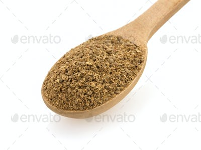 coriander spices and spoon on white