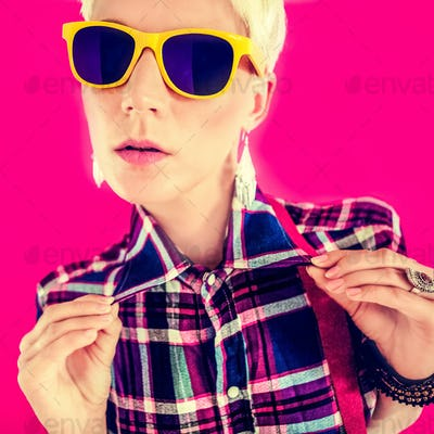 Stylish country girl on a bright pink background