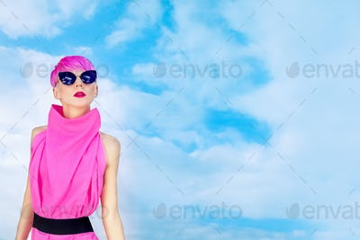 sensual girl with fashion hairstyle on the sky background