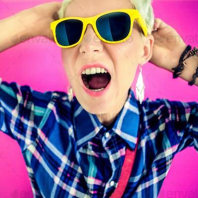 stylish girl  shouts on a bright background