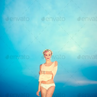 fashion portrait of romantic girl in the blue sky