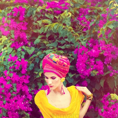 Sensual oriental girl in the flowers