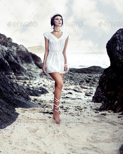 fashion portrait of sensual girl on the rocks