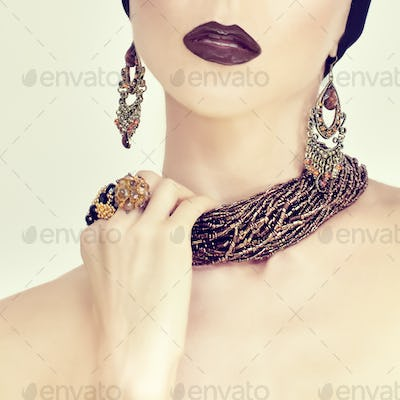 beauty portrait of a sensual girl in jewelry