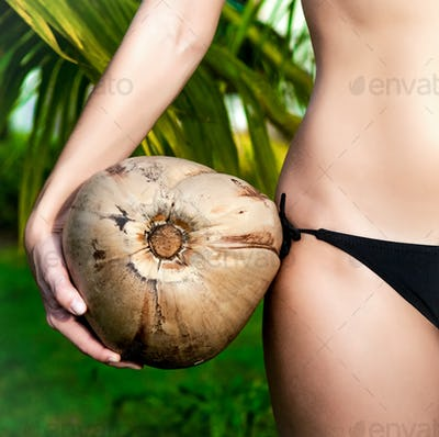 girl holding coconut closeup