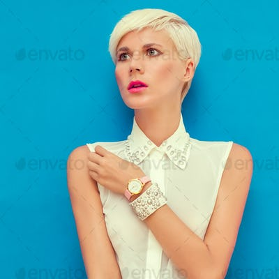 fashion portrait of sensual stylish girl on a blue background
