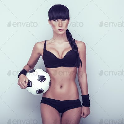 Sports sensual girl with ball