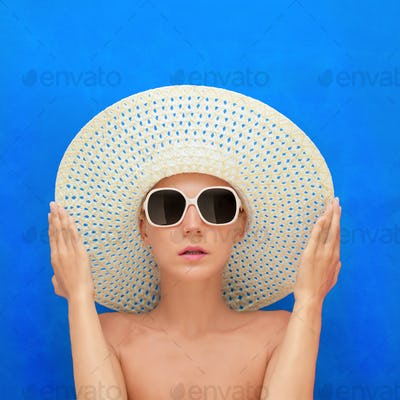 portrait of a girl in a hat on a blue background