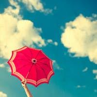 vintage umbrella in the blue sky