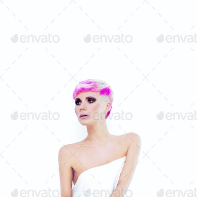 girl with a fashionable haircut on the white background