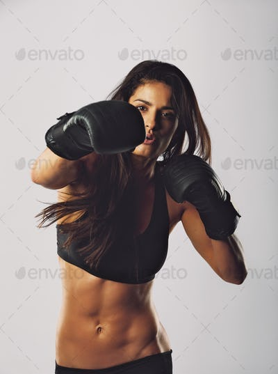 Young sports woman training boxing