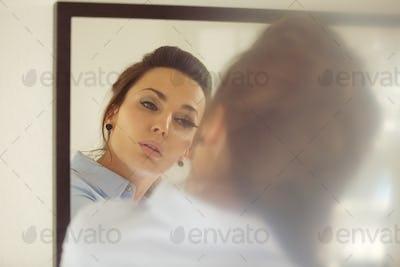 Business woman putting makeup