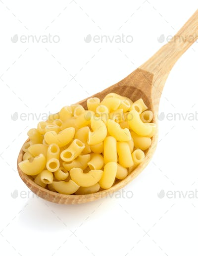 raw pasta in spoon on white