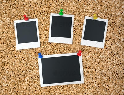 Notice board with blank instant photo prints