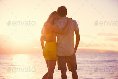 Romantic Couple Watching the Sunset on Tropical Beach