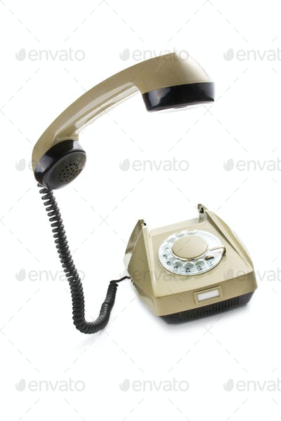 old telephone with lifted handset