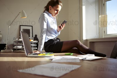 Businesswoman texting while at work