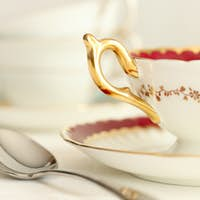 Closeup of a tea cup and spoon